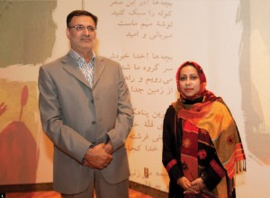 """Erfan Naza Ahari, renowned Iranian author, gave a talk entitled """"Spiritual writing and the challenges of human beings today"""" at the Ottawa Public Library Aug. 14. She's shown here with Hamid Mohammadi, cultural counsellor at the Iranian embassy. (Photo illustration: Dyanne Wilson)"""