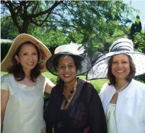 Joyce Kallaghe, wife of Tanzanian High Commissioner Peter Kallaghe, held a reception to bid farewell July 3 at her residence. She asked guests to wear hats. Pictured are, from left, Keiko Nishida, wife of former Japanese Ambassador Tsuneo Nishida; Ms. Kallaghe; and Vera Lucia de Andrade Pinto, wife of Brazilian Ambassador Paulo Cordeiro de Andrade Pinto. (Photo: Ulle Baum).
