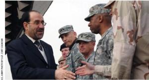 Iraqi Prime Minister Nouri al-Maliki greets U.S. soldiers during Iraqi Army Day.
