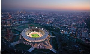 The sun sets over Olympic Stadium in London.