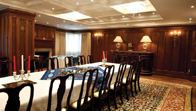 The dining room is part of the large expansion and features new wood paneling that matches the old perfectly.