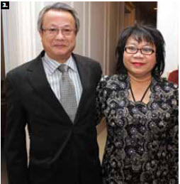 . Brunei High Commissioner Rakiah Lamit, right,  hosted a national day reception at the high commission in March. Thai Ambassador Udomphol Ninnad attended. (Photo: Sam Garcia)