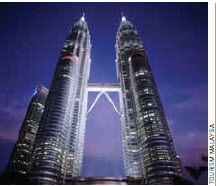 Malaysia has a vibrant business sector, centred around its tallest skyscraper, the Petronas Twin Towers.