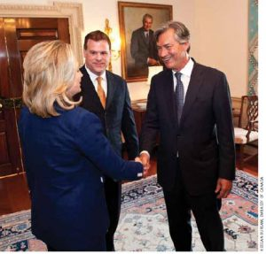 Gary Doer, Canada's ambassador to the U.S., meets U.S. Secretary of State Hillary Clinton and Canadian Foreign Minister John Baird outside Mrs. Clinton's office in Washington.