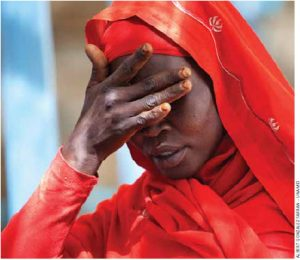 A woman from Kassab camp for Internal Displaced Persons (IDP), in Kutum (North Darfur), shows her sorrow for the increase of rapes in the area.