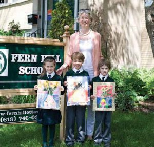 """Children from Fern Hill School took part in an art contest sponsored by the Netherlands Embassy called """"van Gogh goes to school."""" Simone Bakker, second secretary for cultural and political affairs at the embassy, visited the school and children, from left, Marika Garzoni, Connor Douglas (grandson of former Canadian ambassador William Clarke) and Rohan Vermeij. (Photo: Natasha Moine)"""