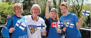 Finnish Ambassador Risto Piipponen and his wife, Marjatta, hosted a gathering to watch the men's championship hockey game between Canada and Finland. From left, Finnish fans Deborah Nieminen, Marjatta Piipponen, Linda Keep and Petra Erkkila. (Photo: Ulle Baum)