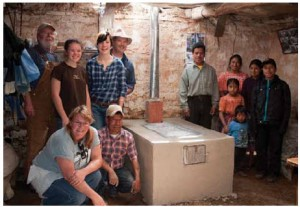 Volunteers for the Guatemala Hot Stove project after they completed a project. Clockwise from top left: Canadian volunteers Keith Walker, Rowan Delgrande, Melissa Cordick, Keith Cordick, Quiche-Maya mason Juan Hernandez Cochojil and Lisa Walker. At right, the family of Micaela Cox-Hernandez and Andres Ramos Garcia, who received the stove.