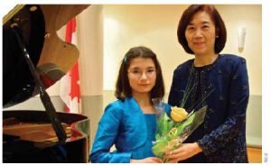 Dr. Chih-Kung Liu, representative of the Taipei Economic and Cultural Office in Canada, and his wife Huey-Pyng Liu, right, hosted a fundraising dinner that featured the music of violinist Maria Kristic, left, among others.