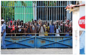Haitians wait for water and supplies being delivered by helicopters as part of relief efforts in Haiti after the 2010 earthquake