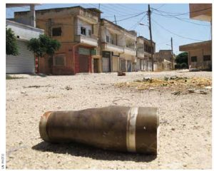 A shell in the middle of the street in Homs, Syria, is a remnant of the heavy attack levelled on the city last year.