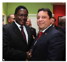 Trinidad and Tobago High Commissioner Philip Buxo, right, hosted a republic day reception, which Kenyan High Commissioner Simon Wanyonyi Nabukwesi attended. (Photo: Sam Garcia).