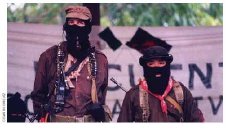 Sub-comandante Marcos, spokesman for the Zapatista Army of National Liberation, and Comandante Tacho in Chiapas in 1999.