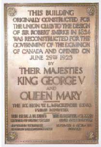 This plaque explains the building's history.