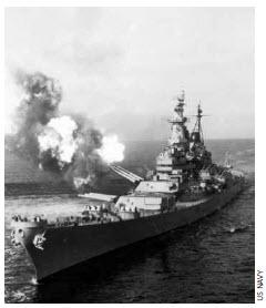 USS Missouri fires a salvo from its 16-inch guns at targets near Chongjin, North Korea.