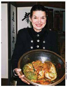 Margaret Dickenson prepares her own  kimchi.
