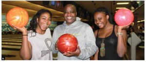 The Canadian Federation of University Women's diplomatic hospitality group hosted its first bowling event at McArthur Lanes. Zambian High Commissioner Bobby Mbunji Samakai, centre, took part with his daughters, Victoria (left) and Precious (right). (Photo: Ulle Baum)