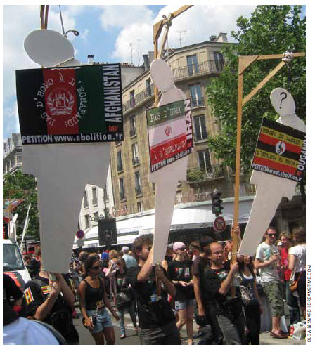 Protesters demonstrate during the gay pride parade in Paris against penalties for gays in several countries, including Nigeria, Saudi Arabia, Pakistan and Yemen.