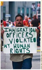 A man at Queen's Park in Toronto during the G8/G20 Summit in 2010 protests his treatment by immigration officers.