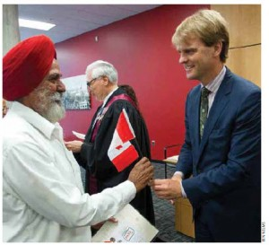 Immigration and Citizenship Minister Chris Alexander attends a citizenship ceremony in  Surrey, B.C.