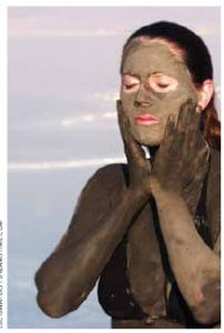 A woman gives herself a mask from mud in Israel's Dead Sea. Nearly eight of 10 Israelis report their health is good to very good.