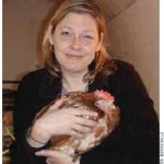 Twyla Francois with a rescued hen.