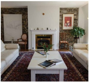 The main reception room of Croatian Ambassador Veselko Grubisic's four-bedroom condo has three large windows facing Sussex Drive, bright oriental carpets and two white sofas.