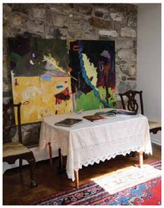 The foyer features bright contemporary art, and a table where visitors can sign the guestbook.
