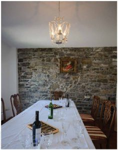 The dining room, where stone walls put the building in its historical context.