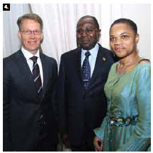 Cameroon High Commissioner Solomon Azoh-Mbi Anu'a-Gheyle, centre, and his wife, Mercy, hosted a national day reception at the Château Laurier. They're shown greeting Swedish Ambassador Teppo Tauriainen. (Photo: Sam Garcia)
