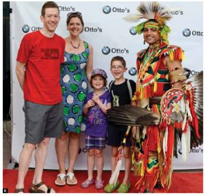 Otto's BMW held a family day event for diplomats at the Canadian Museum of History. From left, James Robertson, Deputy British High Commissioner Corin Robertson, their children, Zoe and Alex and Jason Gullo Mullins, a dancer from the Cherokee Nation and cultural ambassador for the Ottawa-based NGO Aboriginal Experiences. (Photo: Marc Bridgen)