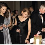 Ball-goers, including former chief of defence staff Rick Hillier (at right), peruse silent auction items.