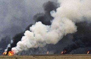 An oil-well set ablaze by the occupation forces of Iraq at the Al Maqwa oil fields in Kuwait during the Iraq invasion of 1991, a precursor to the U.S.-led invasion of Iraq in 2003.