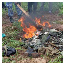 Militia clothing, boots and equipment are destroyed during a disarmament and demobilization mission in Ivory Coast.
