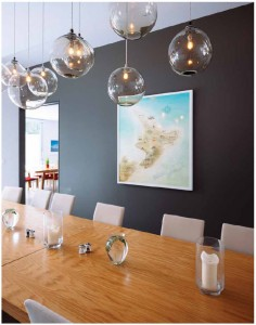 The contemporary furniture comes from a New Zealand-based company, including the wood dining room tables and chairs.