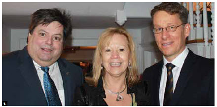 Swedish Ambassador Teppo Tauriainen hosted a traditional Lucia celebration at his residence. From left, MP Mauril Belanger, his wife Catherine, and Mr. Tauriainen. (Photo: Ulle Baum)