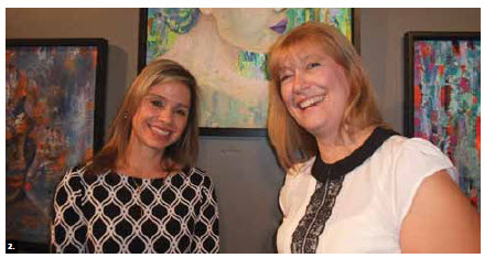 Honduran Ambassador Sofia Lastenia Cerrato Rodriguez, left, and Argentine artist Silvia Bompadre pose in front of Ms Bompadre's paintings. Artwork from 11 Latin American countries was presented at the St. Brigid's Centre for the Arts. (Photo: Ulle Baum)