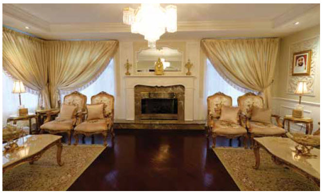 This formal drawing room features gold and cream-coloured sofas and chairs with a tapestry motif, all from the UAE.