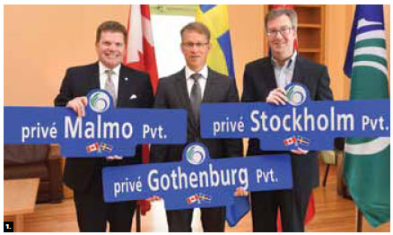 From left, South-Nepean Councillor Steve Desroches, Swedish Ambassador Teppo Tauriainen and Mayor Jim Watson mark the naming of three new streets in Riverside South. The namings commemorate the ties that the City of Ottawa has built with Sweden Ericsson, Ikea, Volvo, H & M and the Ottawa Senators hockey club. (Photo: City of Ottawa)