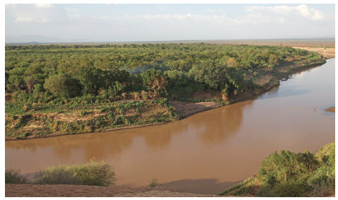 In Southern Ethiopia, China is funding a third Gilgel Gebe Dam, across this, the Omo River, despite World Bank concerns the project will adversely affect local agriculture.