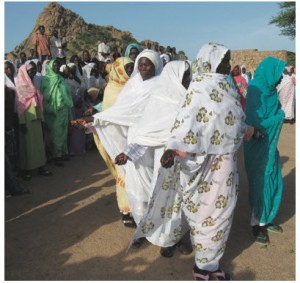 Sudan 2008: A celebratory dance in Kortala, thanking my partner LCdr Janan Sutherland, for arranging to have an addition built on one of the girls' schools (Kortala, Sudan)