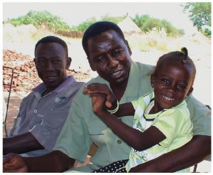Sudan 2008: Alnoor, our interpreter, and his daughter in Kortala, his home village. With the renewed fighting in that area, I worry about what has happened to them all.