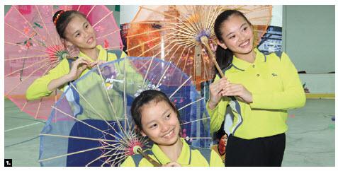 The Taipei Youth Folk Sports Group showcased Taiwan's folk art at Howard Darwin Centennial-Merivale Arena. From left, Left: Yung-Shin Ko, Che-YuYeh, Chieh-Yun Lee. (Photo: Sam Garcia)