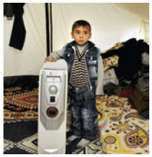 A Syrian refugee in his tent in a Turkish camp.