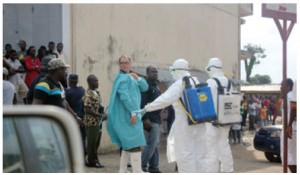 Of more than 17,290 reported cases of Ebola, 10,825 were lab-confirmed and 6,128 people had died by press time in December. Actual numbers are much larger. Here, in the high-mortality Monrovia region of Liberia, people gather for assessment by health workers.