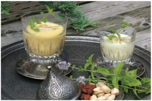 Two versions of traditional Pakistani lassi — one with mango, one with honey.