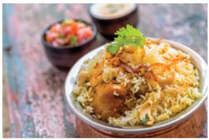 Biryani is a combination of spiced rice, usually cooked with meat or chicken and often vegetables as well.