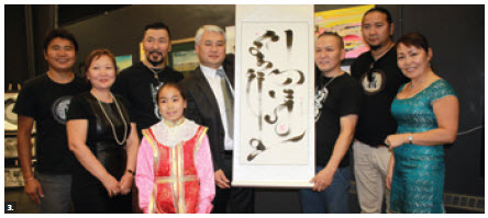 The Embassy of Mongolia hosted a vernissage for an exhibition of Mongolian Art at Ottawa Arts Court. Ambassador Altangerel Radnaabazar (centre) is shown with the group of artists. (Photo: Ulle Baum)