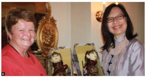 Fisheries Minister Gail Shea, left, was a keynote speaker at a Women Ambassador's (WAO) luncheon hosted by Indonesian Ambassador Dienne Moehario, right, at her residence. Ms Shea is shown receiving a gift of Indonesian dolls. (Photo: Ulle Baum)