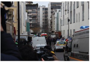 Police officers, emergency vehicles and journalists at the scene two hours after the shooting at French satirical magazine, Charlie Hebdo.